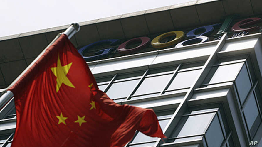 A Chinese national flag waves in front of the former headquarters of Google China in Beijing, June 2, 2011.