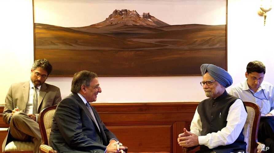 U.S. Secretary of Defense Leon Panetta, second left, speaks with Indian Prime Minister Manmohan Singh during a meeting at the Prime Minister's office in New Delhi, India, June 5, 2012.