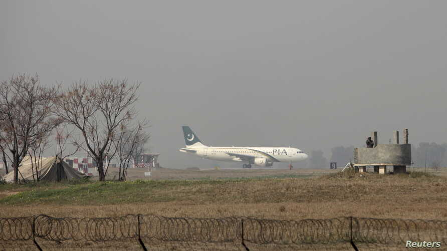 A Pakistan International Airlines (PIA) passenger plane prepares to take off from the Benazir International airport in Islamabad, Feb. 9, 2016.