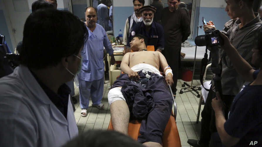 An injured man is brought into a hospital following deadly blasts at a wrestling club in Kabul, Afghanistan, Sept. 5, 2018.