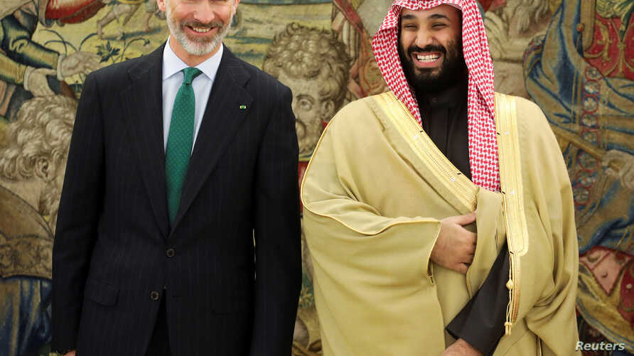 Saudi Arabia's Crown Prince Mohammed bin Salman laughs with Spain's King Felipe at the Zarzuela Palace outside Madrid, Spain, Apr. 12, 2018.