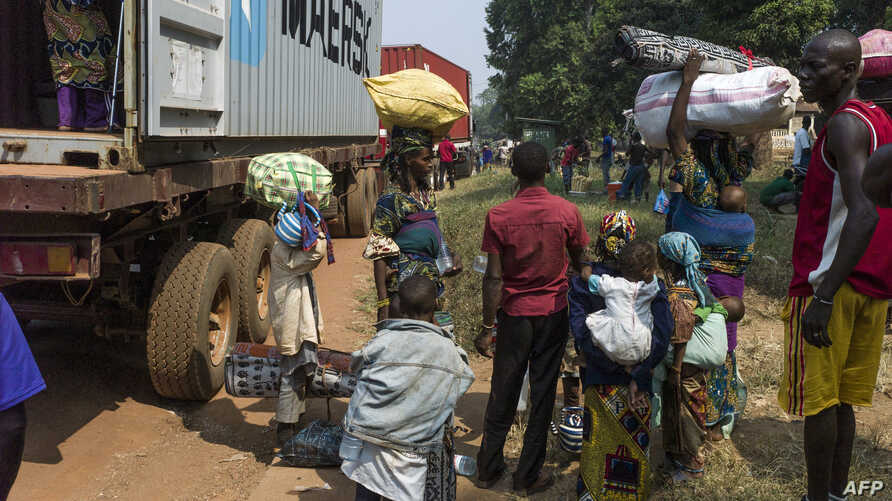 People flee Bangui for Cameroon by road, Feb. 22, 2014.