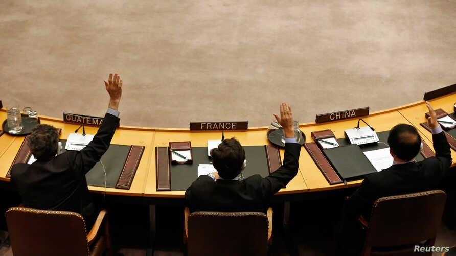 Members of the United Nations Security Council vote to tighten sanctions on North Korea at the United Nations Headquarters in New York, March 7, 2013.