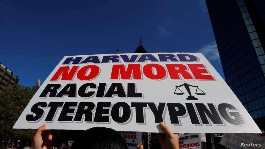 """A supporter carrying a """"Harvard No More Racial Stereotyping"""" sign attends the """"Rally for the American Dream - Equal Education Rights for All,"""" ahead of the start of the trial in a lawsuit accusing Harvard University of discriminating against Asian-Am"""