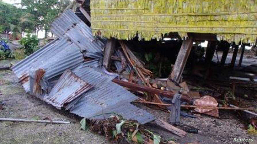 A damaged house is seen after a tsunami hit the Venga village on Solomon Islands, February 7, 2013.