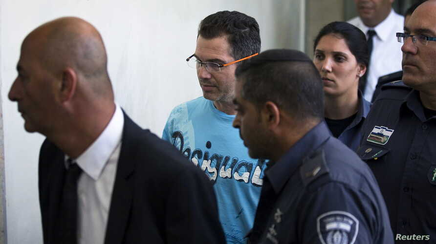 FILE - Ziv Orenstein (C), who is accused by U.S. authorities of engaging in a stock manipulation scheme involving U.S. penny stocks, arrives at a courtroom at the Jerusalem Magistrates Court July 22, 2015.