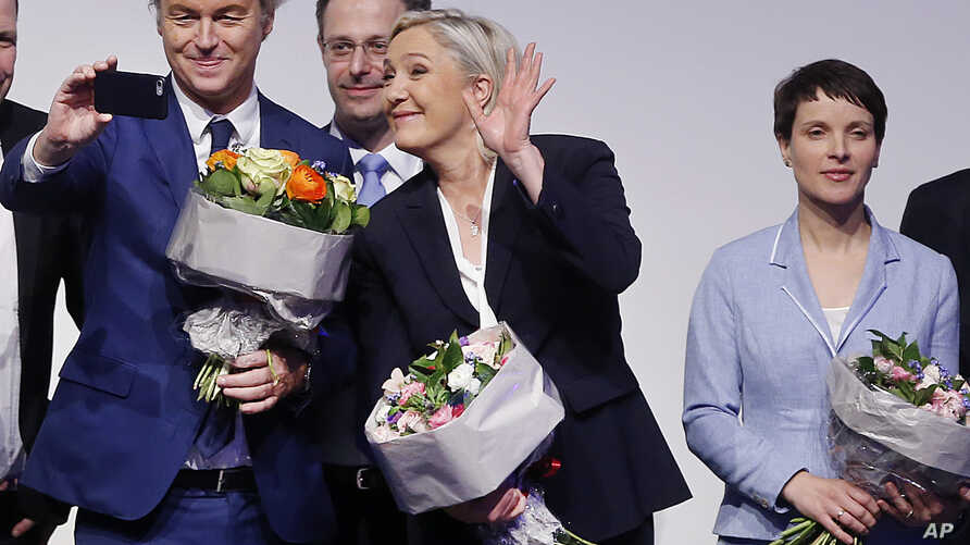 AfD (Alternative for Germany) chairwoman Frauke Petry, right, Far-right leader and candidate for next spring presidential elections Marine le Pen from France, center, and Dutch populist anti-Islam lawmaker Geert Wilders stand together after their spe