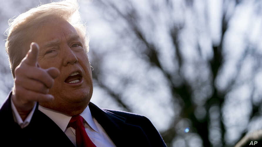 President Donald Trump speaks to reporters before boarding Marine One on the South Lawn of the White House in Washington, March 13, 2018, to travel to Andrews Air Force Base, Maryland. Trump fired Secretary of State Rex Tillerson on Tuesday and said
