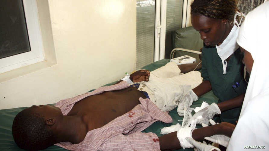 Nurses attend to a victim of the clashes between the pastoralists and farmers within the Tana Delta region, at the Malindi District hospital, Kenya, September 7, 2012.