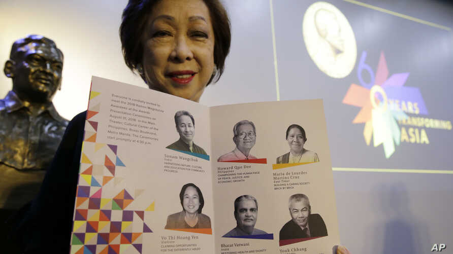 Magsaysay Award Foundation President Carmencita Abella poses with pictures of this years' Magsaysay awardees, regarded as an Asian version of the Nobel Peace Prize, in Manila, Philippines, July 26, 2018.