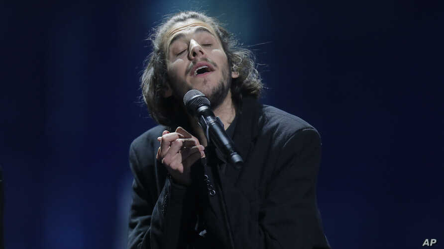 """Salvador Sobral from Portugal performs the song """"Amar pelos dois"""" after winning the Final of the Eurovision Song Contest, in Kiev, Ukraine, May 13, 2017."""