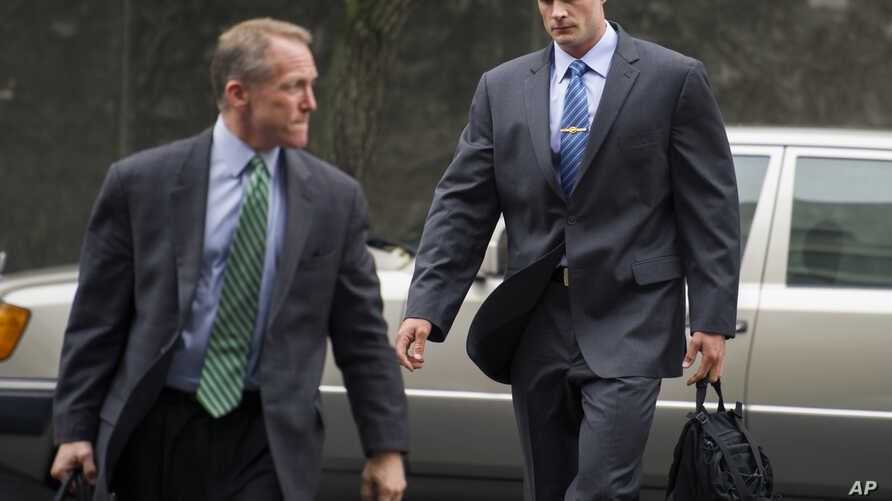 Former Blackwater Worldwide guard Evan Liberty, right, arrives at federal in Washington, June 11, 2014.