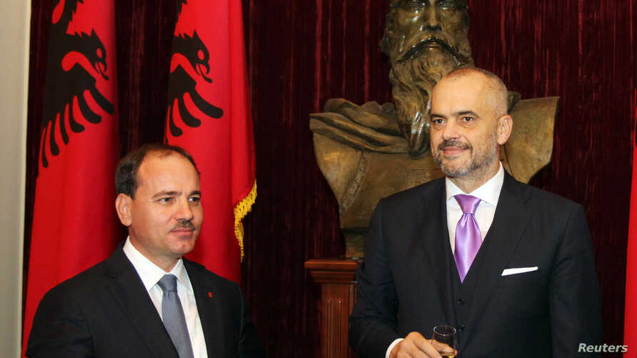 FILE - Albania's Prime Minister Edi Rama, right, and President Bujar Nishani, pictured during a government swearing-in ceremony in Tirana, Sept. 15, 2013, are among the officials U.S. Secretary of State John Kerry will confer with Sunday, Feb. 14, 20