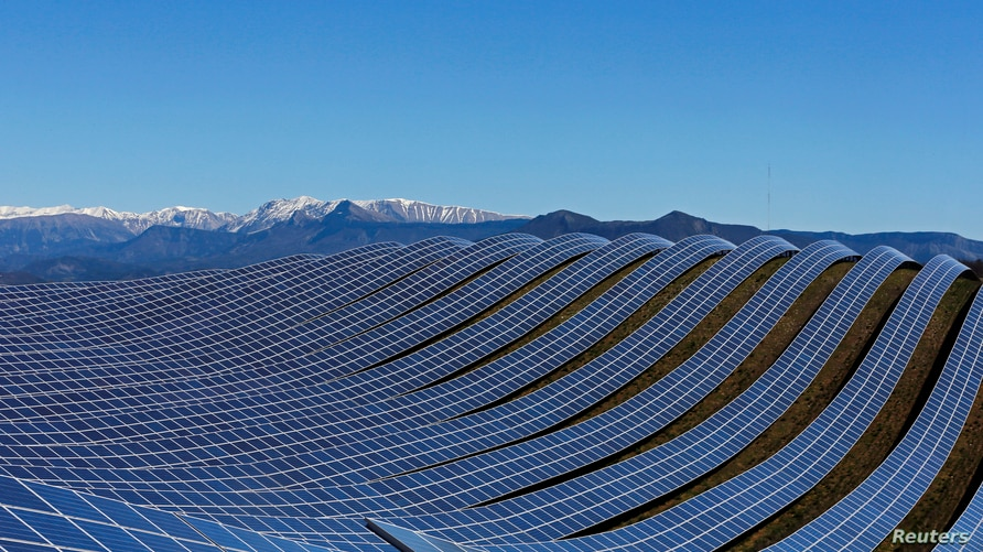 A general view shows solar panels to produce renewable energy at the photovoltaic park in Les Mees, in the department of Alpes-de-Haute-Provence, southern France March 31, 2015. The solar farm of the Colle des Mees, the biggest in France, consists of