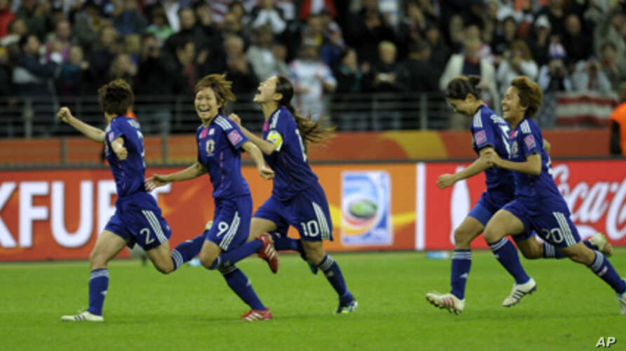 Japanese players celebrate after their team won the Women's World Cup of soccer.