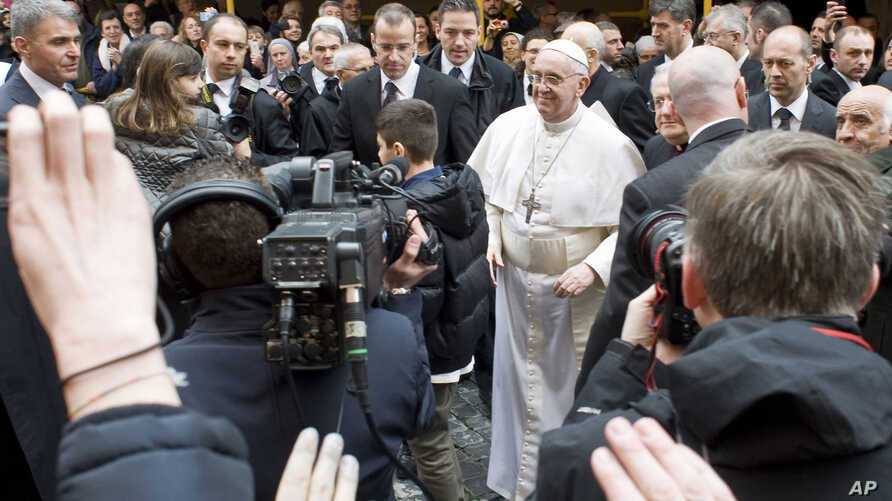 Pope Francis greets faithful at the Vatican, March 17, 2013.