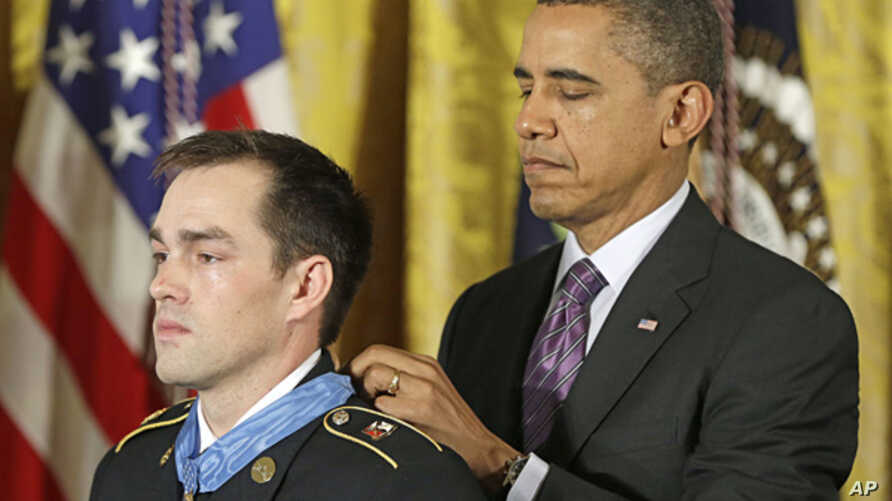 President Barack Obama bestows the Medal of Honor on retired Staff Sgt. Clinton Romesha for conspicuous gallantry, Feb. 11, 2013,  in the East Room of the White House.
