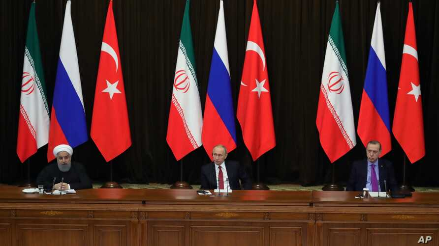 FILE - Turkey's President Recep Tayyip Erdogan, right, Russia's President Vladimir Putin, center, and Iran's President Hassan Rouhani are seen at a news conference following their talks on Syria, in Russia's Black Sea resort of Sochi, Russia, Nov. 22