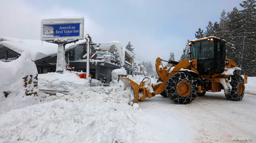 A plow clears snow after a heavy winter storm in Tahoe City, California, Jan. 11, 2017. A storm that struck California, leaving heavy snowfall behind, has moved to the Midwest, where it is leaving freezing rain and ice.