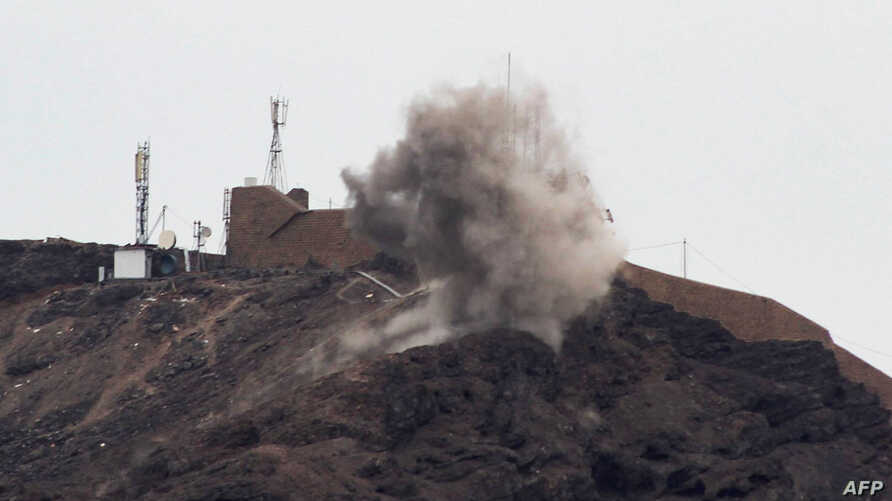 Smoke billows from a hilltop during clashes between fighters from Yemen's southern separatist movement and forces loyal to the Saudi-backed president in the country's second city of Aden on Jan. 28, 2018.