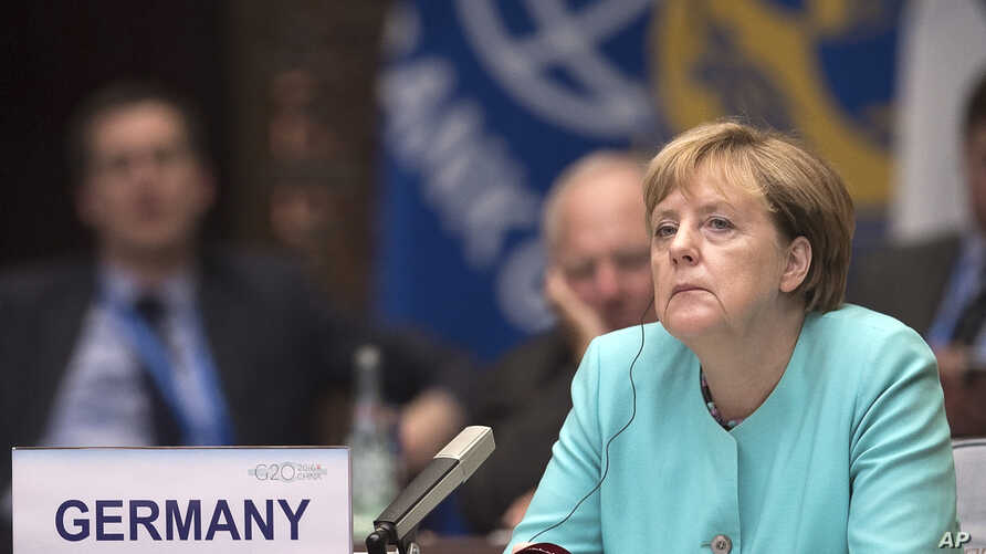 German Chancellor Angela Merkel listens to Chinese President Xi Jinping's speech during the opening ceremony of the G20 Leaders Summit in Hangzhou, Sept. 4, 2016.