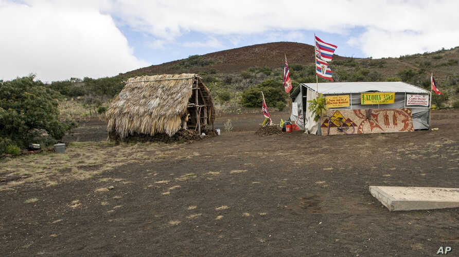 FILE - The base camp for protesters of the Thirty Meter Telescope project occupies a site near the summit of Mauna Kea, Aug. 31, 2015. Hawaii's land board on Thursday granted a construction permit for a giant telescope on a mountain that Native Hawai