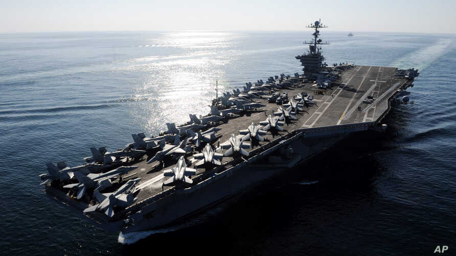 In this Nov. 12, 2011photo provided by the U.S. Navy, the Nimitz-class aircraft carrier USS John C. Stennis (CVN 74) transits the Straits of Hormuz.