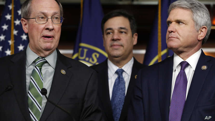 House Judiciary Committee Chairman Rep. Bob Goodlatte, R-Va., left, speaks next to Rep. Raul Labrador, R-Idaho, and Rep. Michael McCaul, R-Texas, Jan. 10, 2018, on Capitol Hill in Washington.