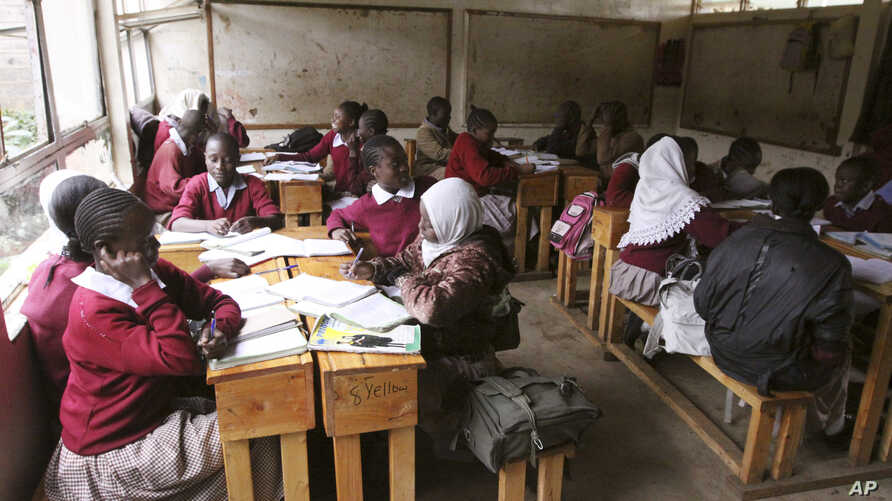 FILE - Pupils at the Toi Primary School in Nairobi, Kenya sit in a classroom and study without a teacher, because the teachers are on strike.