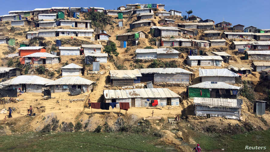 FILE - A deforested section of the Chakmakul camp for Rohingya refugees clings to a hillside in southern Bangladesh, Feb. 13, 2018.