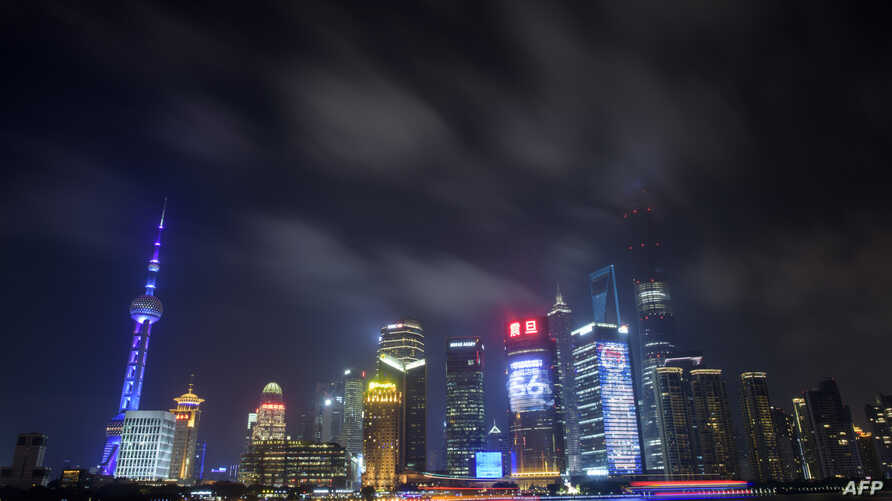This photo taken on July 20, 2015 shows clouds above the financial district of Pudong in Shanghai.