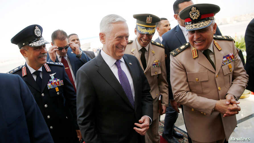 Egypt's Minister of Defense Sedki Sobhi (R) greets U.S. Defense Secretary James Mattis (C) upon his arrival at Cairo International Airport in Cairo, Egypt, April 20, 2017.