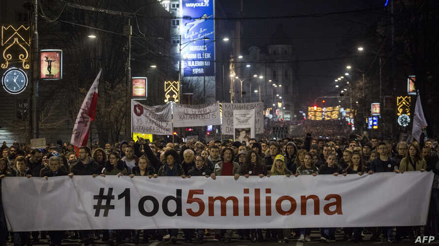 Protesters hold a banner reading '1 out of 5 million' during a demonstration against President Aleksandar Vucic, in Belgrade, Serbia, on Feb. 9, 2019.