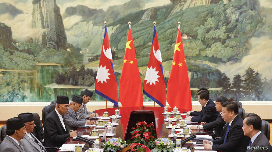 Chinese President Xi Jinping (2nd-R) meets Nepal Prime Minister Khadga Prasad Sharma Oli (2nd L) at the Great Hall of the People in Beijing, China March 21, 2016.