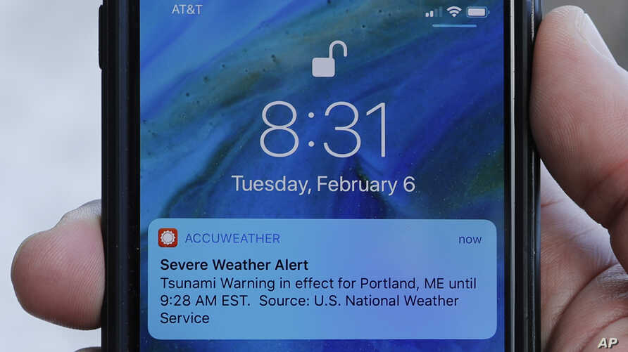 FILE - An alert is displayed on a phone Feb. 6, 2018, in Portland, Maine.