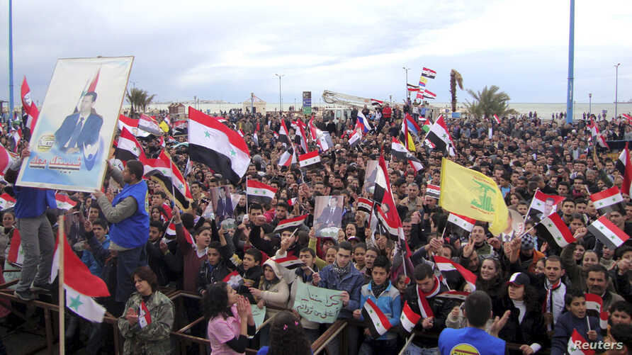 Supporters of Syria's President Bashar al-Assad attend a rally in the northern port city of Tartous, Syria, Jan. 12, 2012.