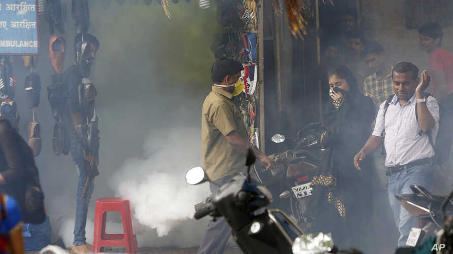 A municipal worker fumigates an area outside a train station to check the spread of mosquito-borne diseases in Mumbai, India, Sept. 3, 2016. The Zika virus has surfaced for the first time in India, with three cases. The patients have recovered.