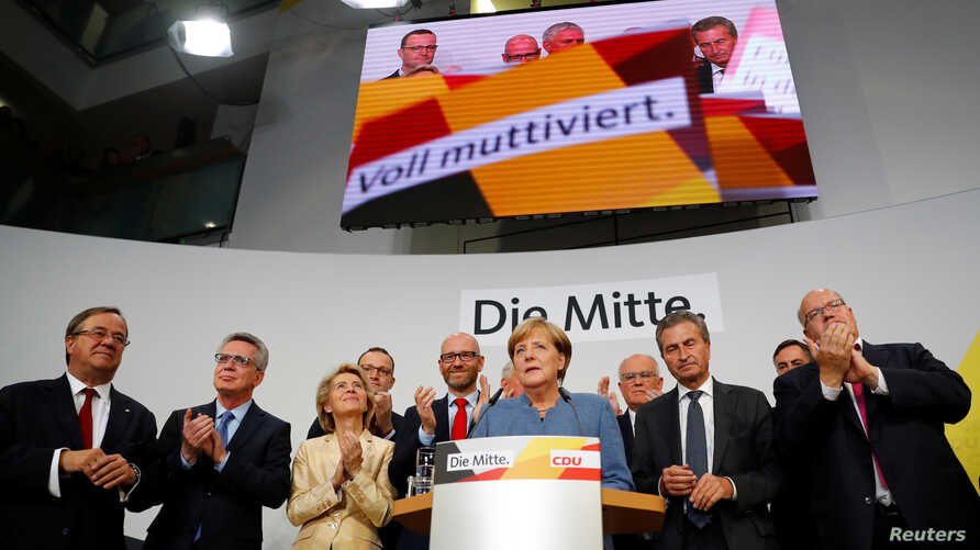 Christian Democratic Union CDU party leader and German Chancellor Angela Merkel reacts on first exit polls in the German general election (Bundestagswahl) in Berlin, Sept. 24, 2017.
