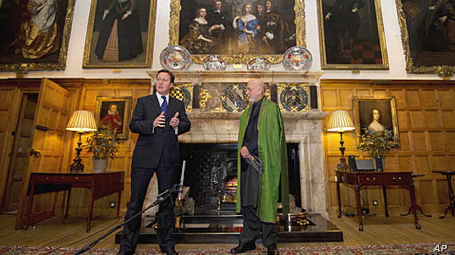 British Prime Minister David Cameron, left, speaks during a press conference with President Hamid Karzai of Afghanistan at the Prime Minister's country residence of Chequers, at Ellesborough west of London, January 28, 2012.