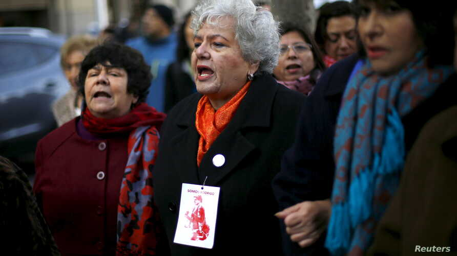 Veronica De Negri (C), mother of 19-year-old U.S. student Rodrigo Rojas who was burned alive and killed during a Santiago labor strike in 1986 along with Carmen Gloria Quintana (R) who suffered serious injuries, and Alicia Lira, relative of a human r