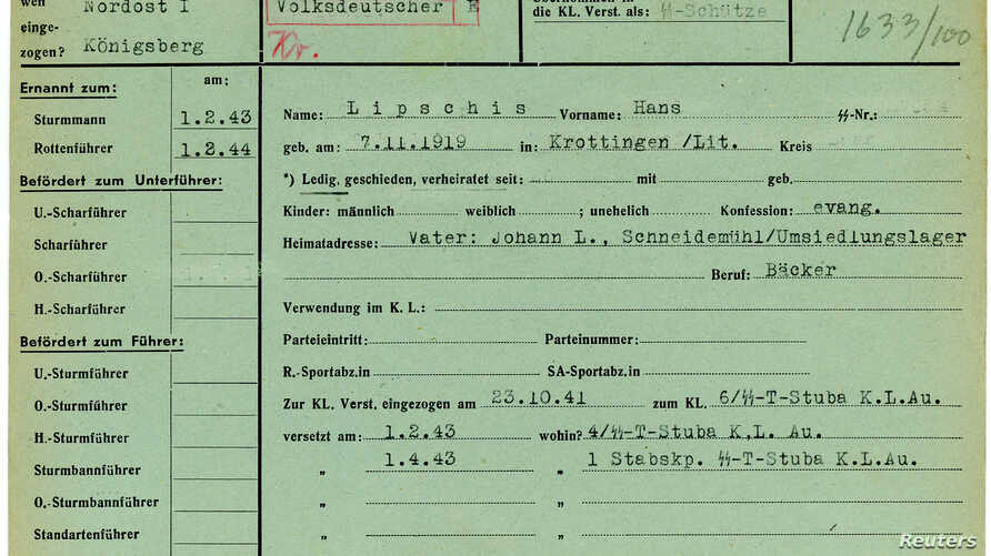 The 1941 military service record of SS soldier Hans Lipschis is shown in this undated handout photograph provided by the Muzeum Auschwitz-Birkenau.