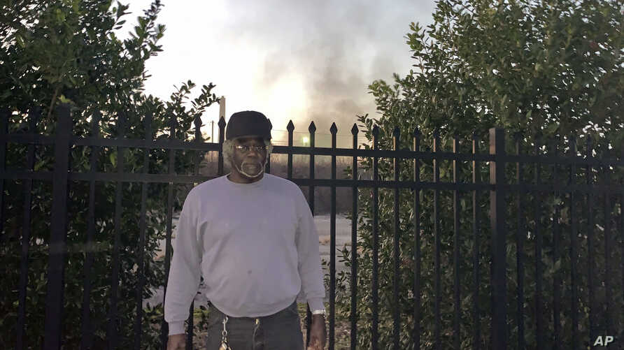 Charlie Powell stands outside one of the industrial sites at the 35th Avenue Superfund site in Birmingham, Ala., Wednesday, Jan. 9, 2019. The EPA has been removing contaminated soil from yards in the neighborhoods within the site.
