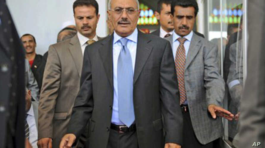 Yemeni President Ali Abdullah Saleh, center, surrounded by guards,  arrives for a meeting with his supporters during a gathering in a soccer stadium in Sana'a, March 10, 2011