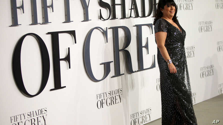 """FILE - Author E.L. James poses for photographers at the British premiere of the film """"Fifty Shades of Grey"""" in London, Feb. 12, 2015."""