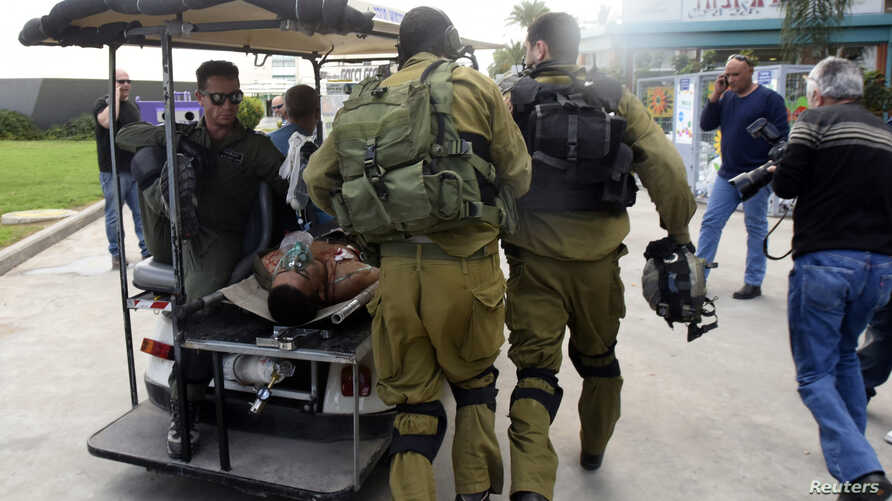An Israeli soldier, wounded in a firefight along the border with Gaza, is transported to hospital in the southern city of Beersheba, Dec. 24, 2014.