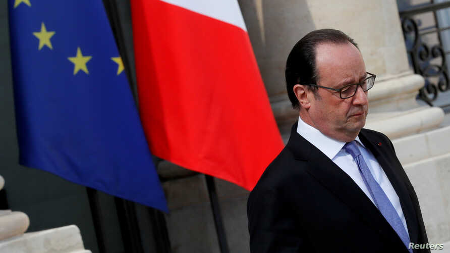 French President Francois Hollande leaves the Elysee Palace in Paris, France, July 15, 2016.