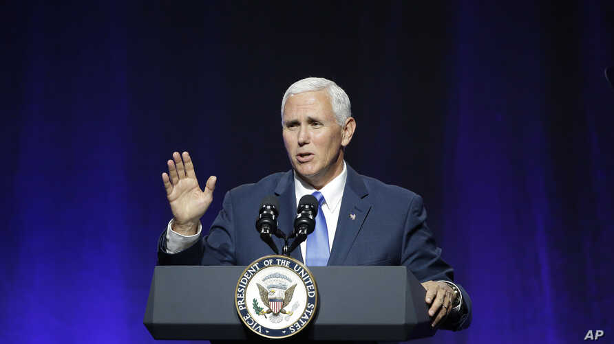 """Vice President Mike Pence waves goodbye as he wraps up an address to a NGA session titled """"Collaborating to Create Tomorrow's Global Economy,"""" July 14, 2017, in Providence, R.I."""