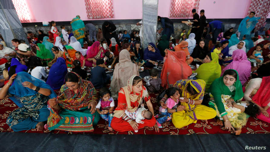 Afghan Hindu and Sikh families wait for lunch inside a Gurudwara, or a Sikh temple, during a religious ceremony in Kabul, Afghanistan, June 8, 2016.