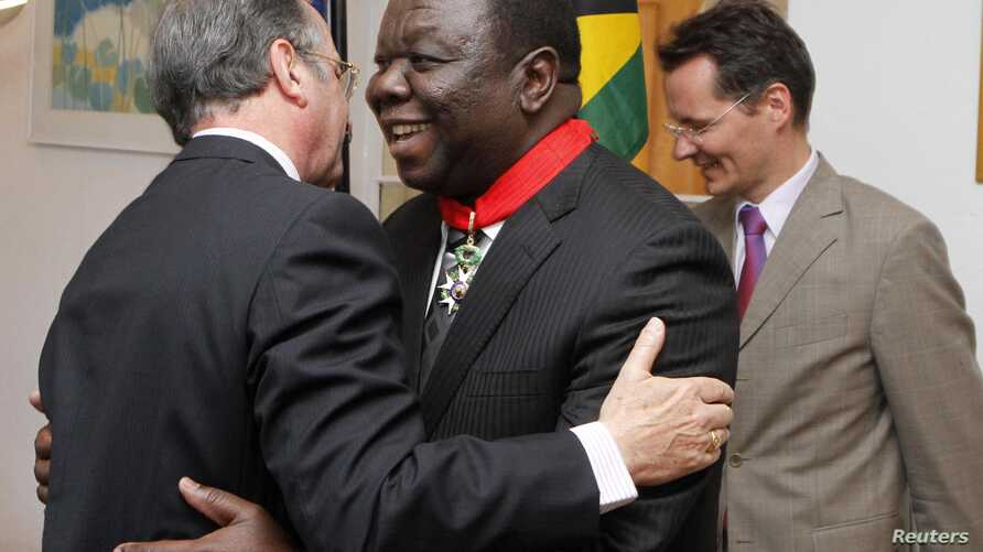 Zimbabwean Prime Minister Morgan Tsvangirai (C) is congratulated by the French Ambassador to Zimbabwe Francois Ponge (L) and his deputy Dietmar Petrausch after receiving the Commander of the Legion of Honor in Harare, Zimbabwe, August 21, 2012.