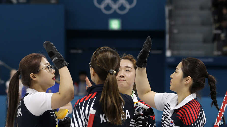 "South Korea's women's curling team celebrate after beating Russian athletes during their match at the 2018 Winter Olympics in Gangneung, South Korea, Feb.21, 2018. The team known as the ""Garlic Girls"" came into the Pyeongchang Games as the underdog. ..."